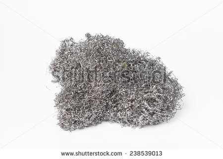 Free A steel wool dishwashing isolated on a white background.