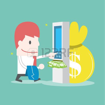 Businessman Withdrawing Money From Credit Card At ATM Royalty Free.
