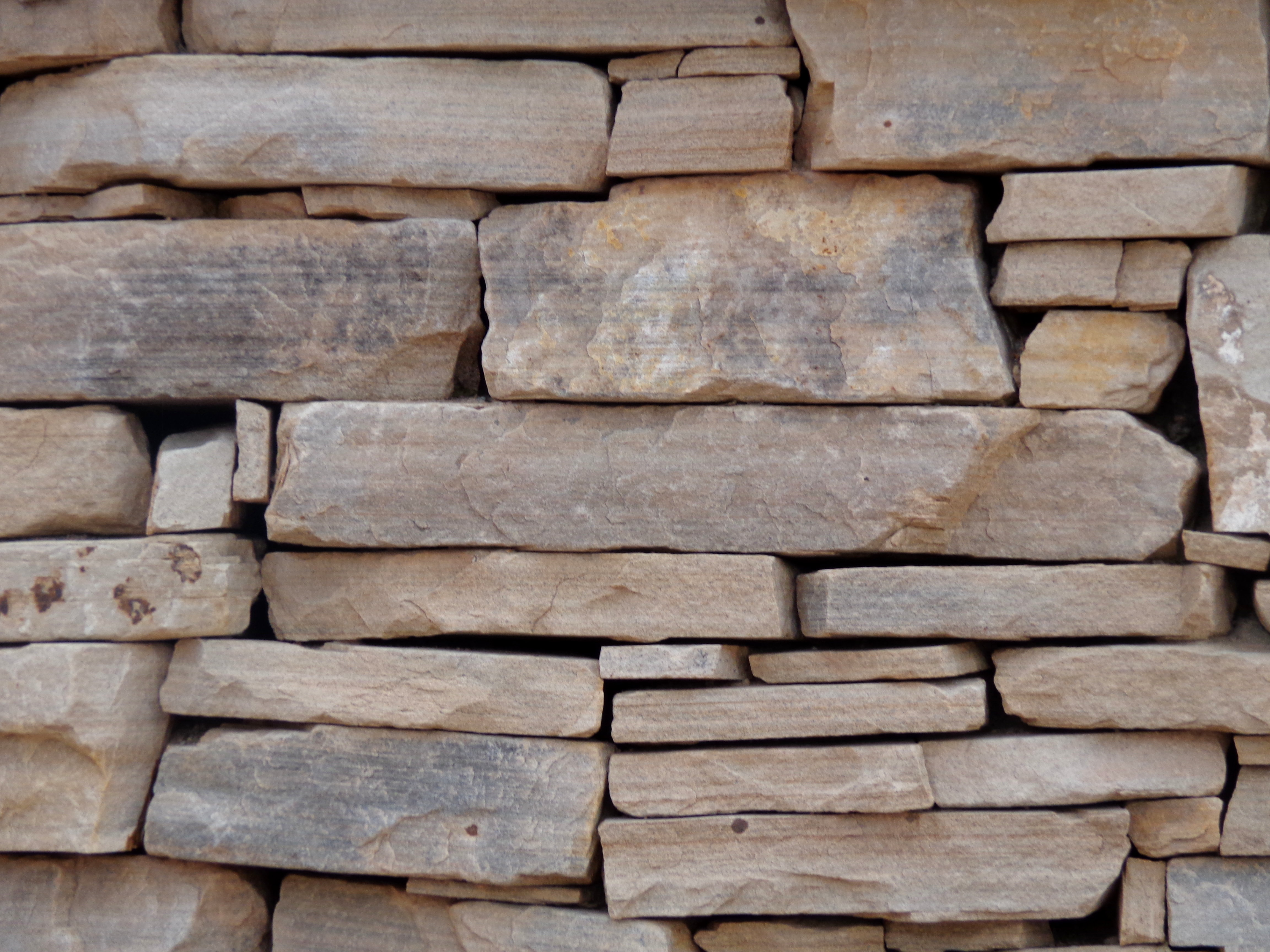 Sandstone Rock Wall without Mortar Texture Picture.