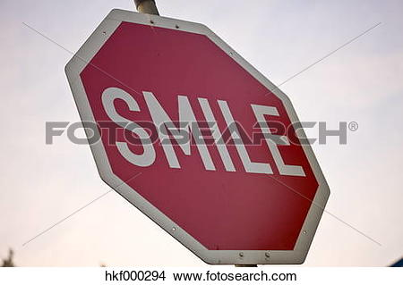 Stock Photo of Germany, Wolfsburg, Smile word on ston sign, close.