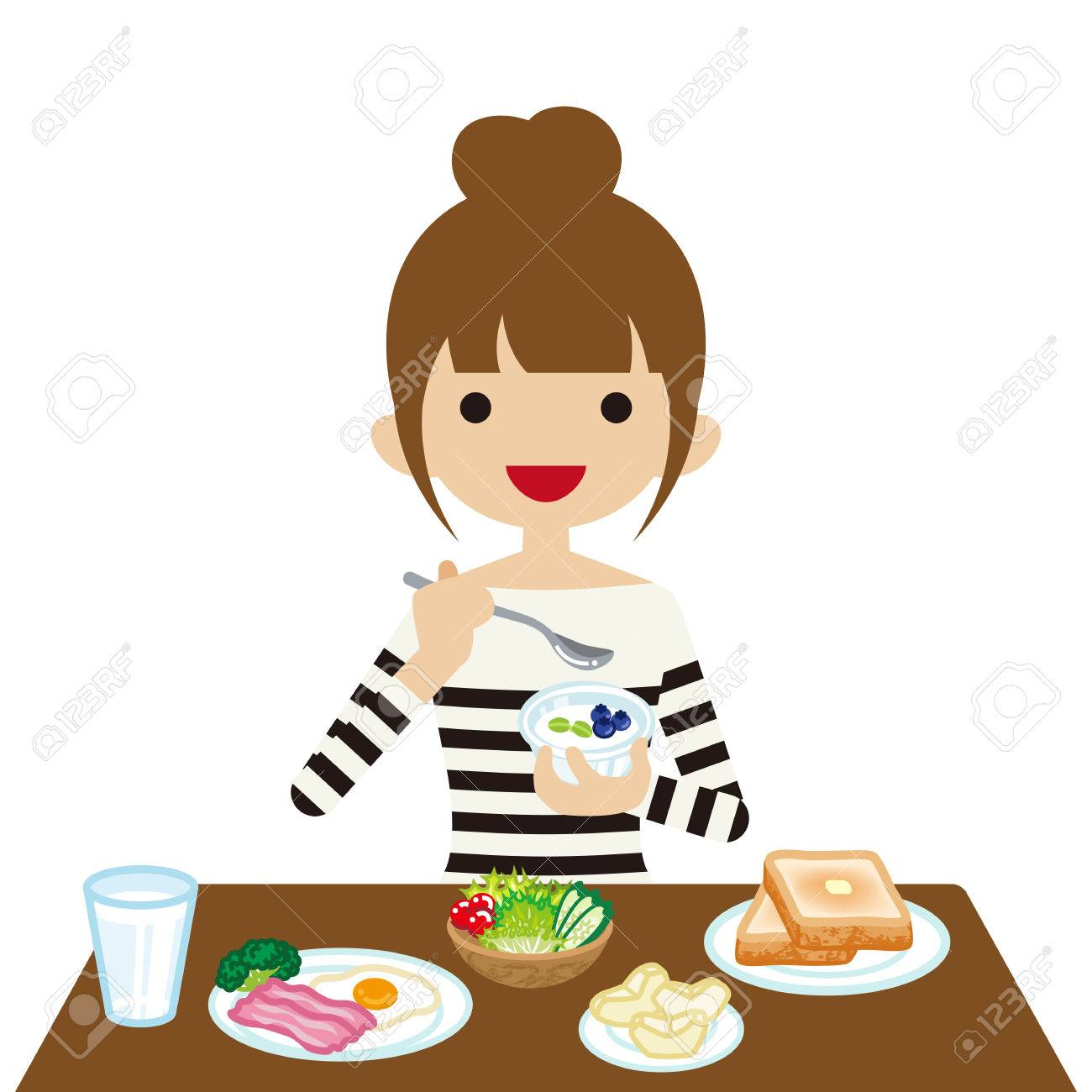 Young woman eating breakfast.