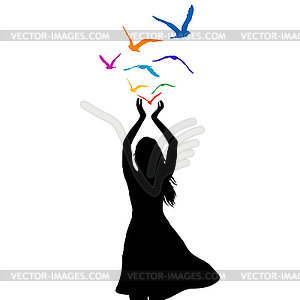 Abstract woman silhouette with birds flying fr.