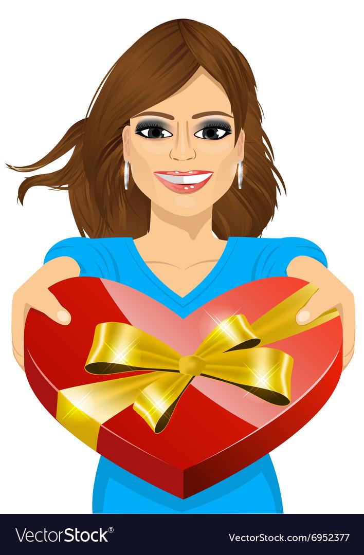 Woman handing over a heart shaped box.