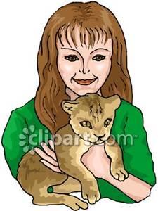 Woman Holding A Brown Kitten.