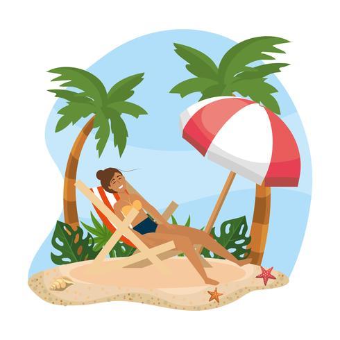 Woman relaxing in beach chair under umbrella.