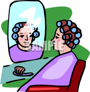 Woman With Curlers In A Salon.