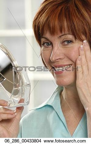 Stock Photo of Head and shoulders front view portrait woman.
