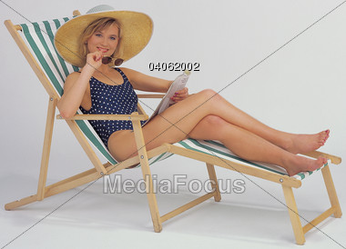 Stock Photo Woman straw hat sitting beach Clipart.