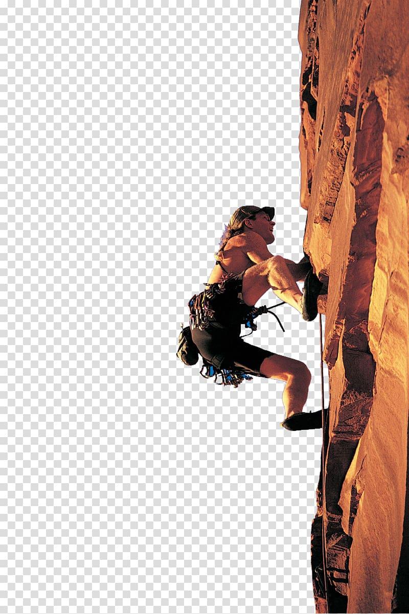 Man climbing on brown cliff under blue sky, Sport climbing.