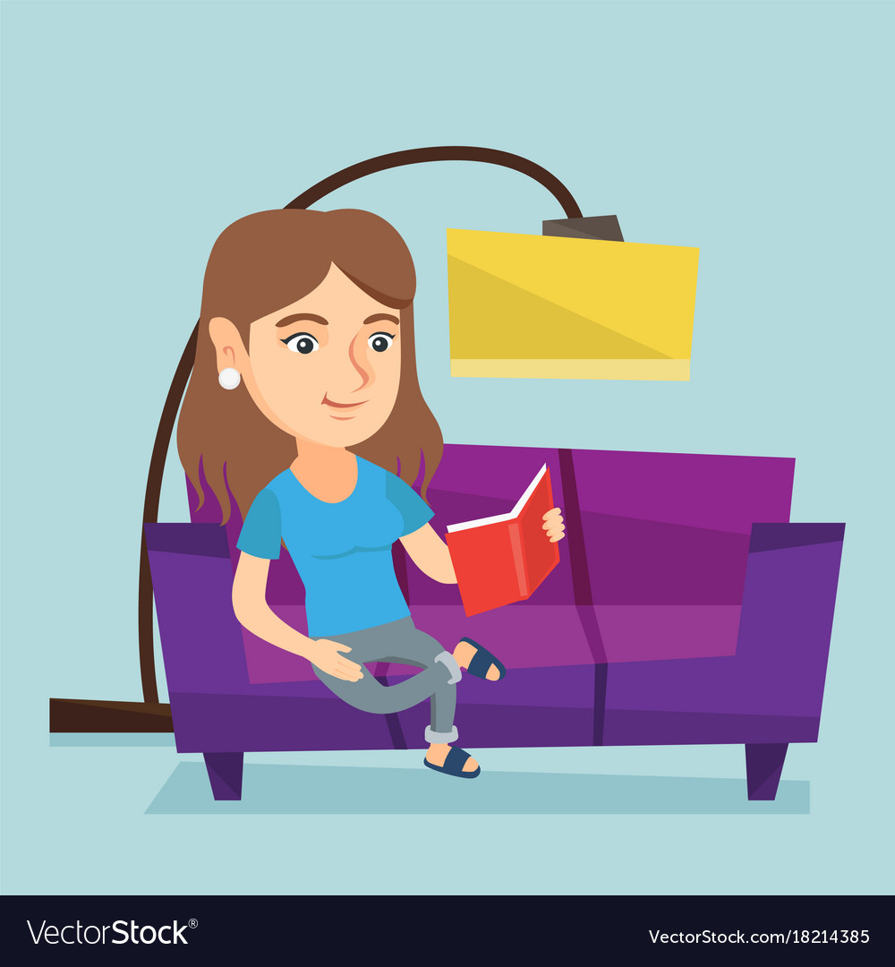 Young caucasian woman reading a book on sofa.