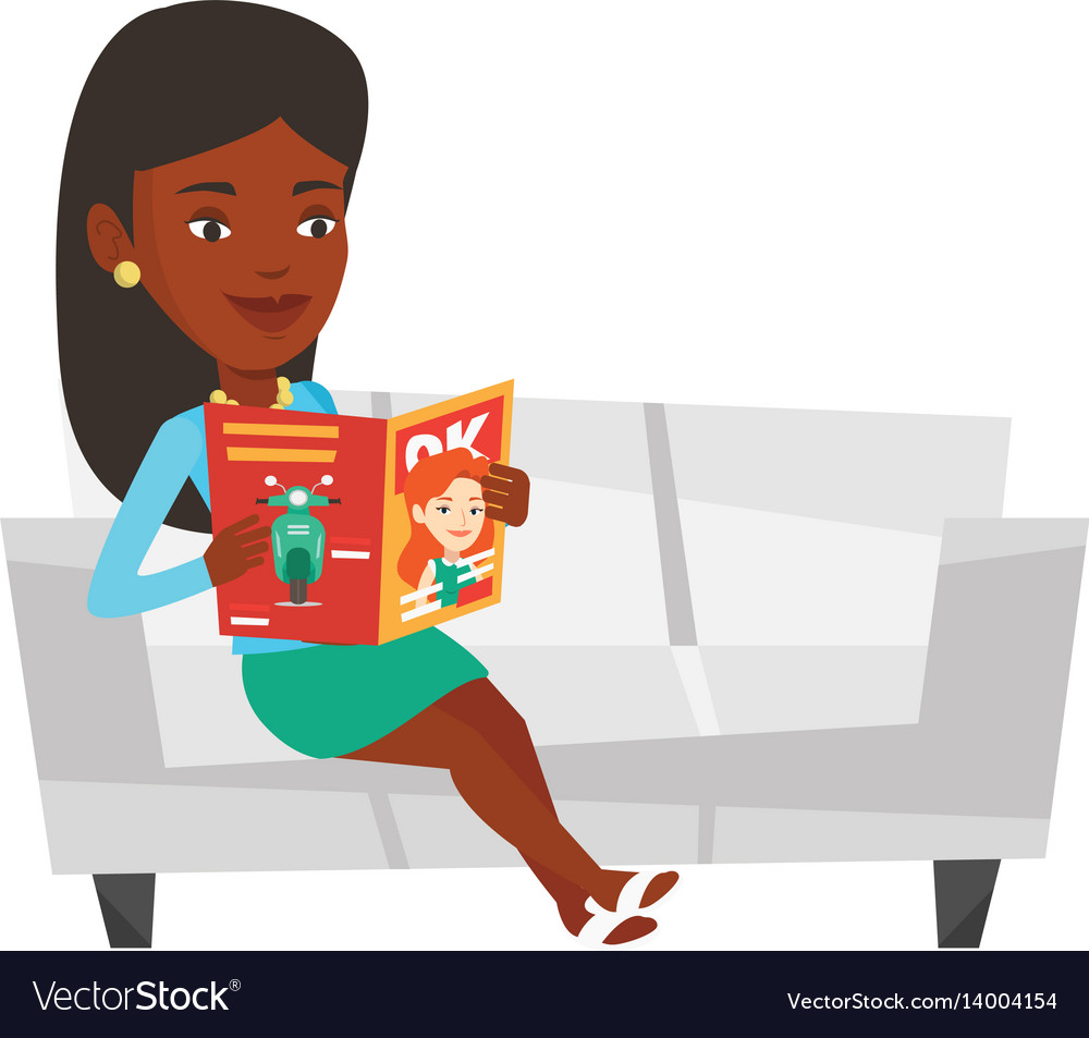 Woman reading magazine on sofa.