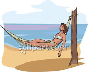 A Woman Relaxing In a Hammock on the Beach Royalty Free.