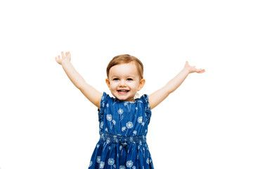 very happy toddler girl with arms outstretched up and a.