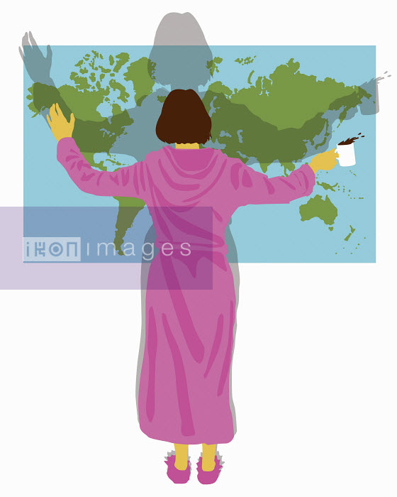 Ikon Images Woman in bathrobe with arms outstretched.