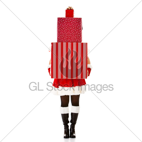 Christmas: Woman Holding Stack Of Gifts · GL Stock Images.