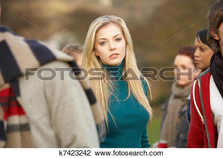 Stock Photo of Teenage Girl Surrounded By Friends In Outdoor.