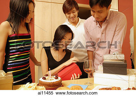 Stock Image of Woman opening gifts, surrounded by friends. ai11455.