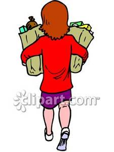 Woman Walking With Two Bags Of Groceries.