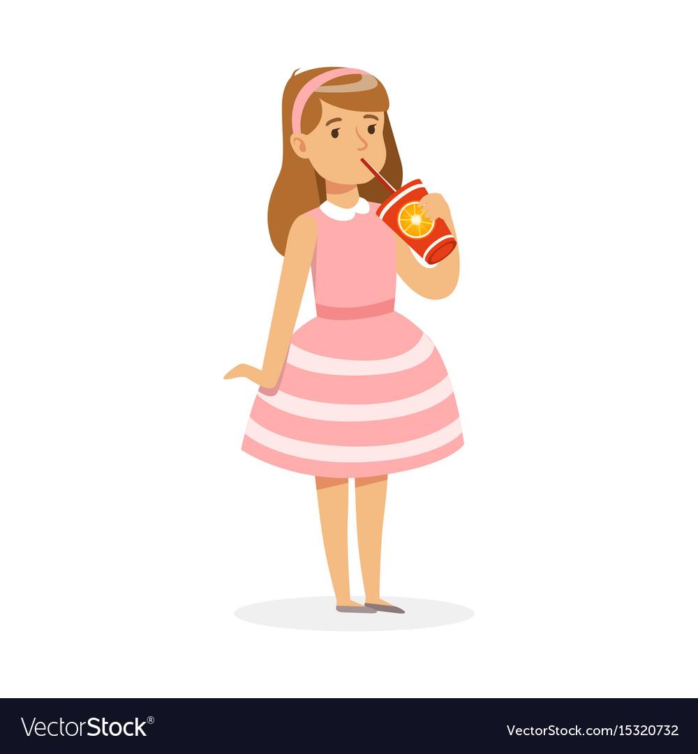 Cute girl in pink dress drinking a fresh juice.
