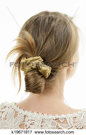 Picture of Young woman with casual messy bun hairdo k19671817.