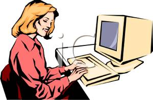 A Woman Working At a Computer.