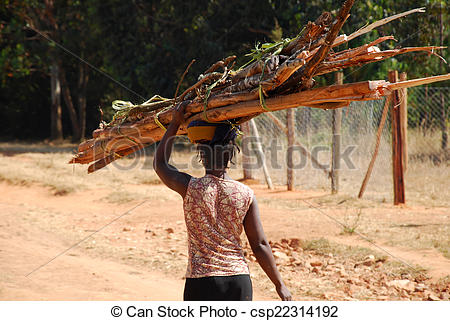 Stock Photographs of An African woman while carrying a load of.