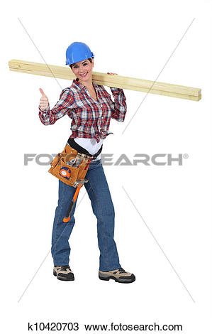 Stock Photo of Woman carrying two planks of wood k10420703.