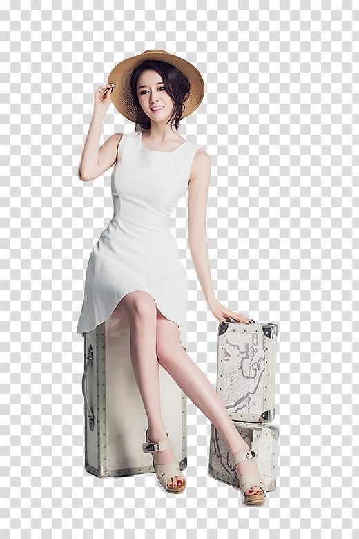 Ji Yeon, woman in white dress sitting on luggage wearing.