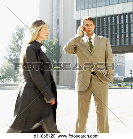 Stock Photography of Side profile of a woman in a trench coat.