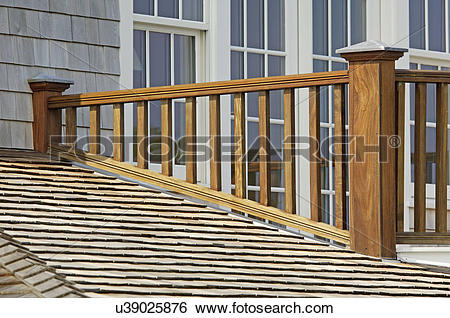 Stock Images of Wooden balcony railing and shingled roof u39025876.