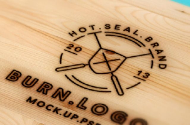 A fresh looking wood burning psd logo mockup with a.