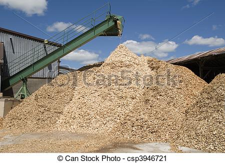 Stock Photography of wood chips pouring from conveyor csp3946721.