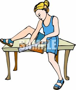 Image: A Girl Sitting on a Table Cutting Wood.