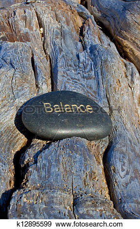 Stock Photograph of rock with balance written in gold. k12895599.