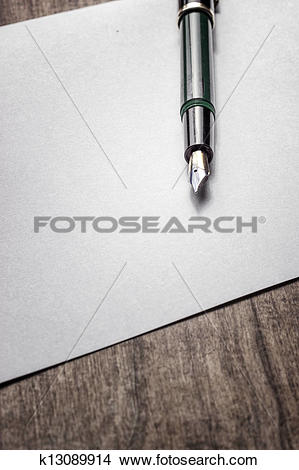 Stock Photo of Fountain pen on old wood k13089914.