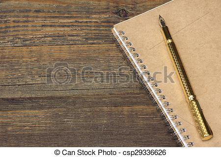 Stock Photo of Notepad With Gold Fountain Pen On The Old Wood.