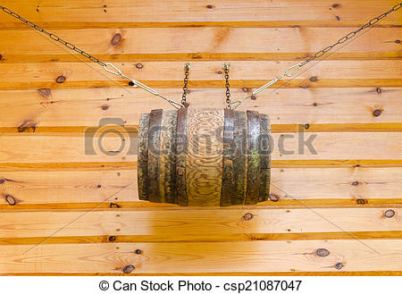Stock Photo of gable of wooden rural house and barrel with chains.