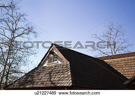 Stock Photograph of Small Gable with Window and Wood Shingle Roof.