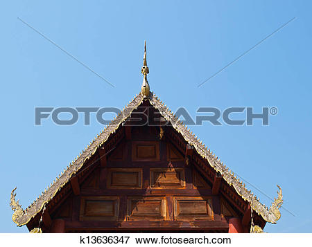Picture of Traditional wooden gable of Buddhist vihara having bee.