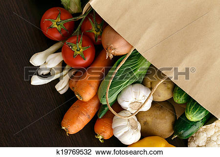 Stock Photo of Vegetables on wood background with space for text.