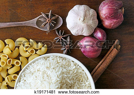 Stock Photography of eastern food spice herb rice garlic red onion.