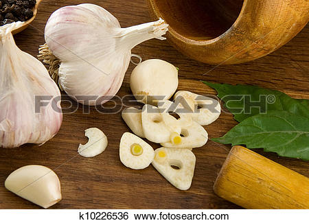 Stock Images of set of garlic nutrition and healthy food on wood.