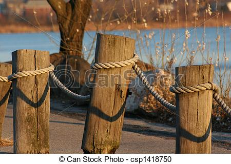 Stock Photography of Wood & Rope fence along water.