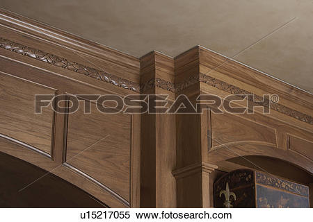 Stock Image of ARCHITECTURAL TRIM: light stained wood, paneled.