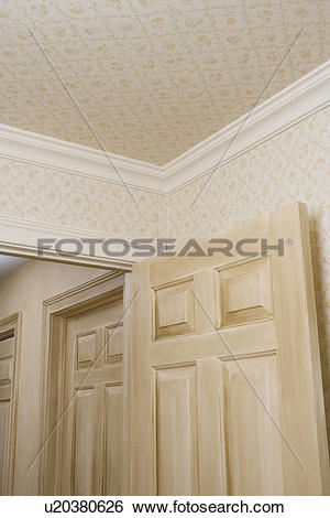 Stock Images of ARCHITECTURAL TRIM: small pattern wallpaper on.
