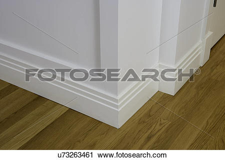 Stock Photography of ARCHITECTURAL TRIM: baseboard detail, wood.