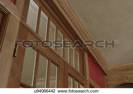 Stock Photo of ARCHITECTURAL TRIM: light stained wood, transom.