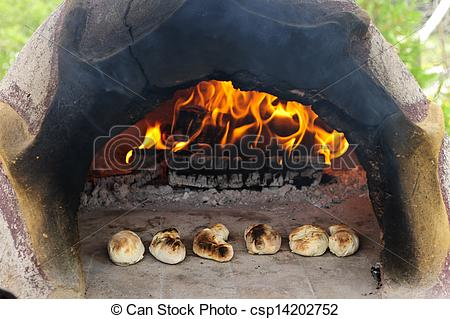 Stock Images of Stone wood oven baking bread.