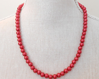 Red pearl necklace.