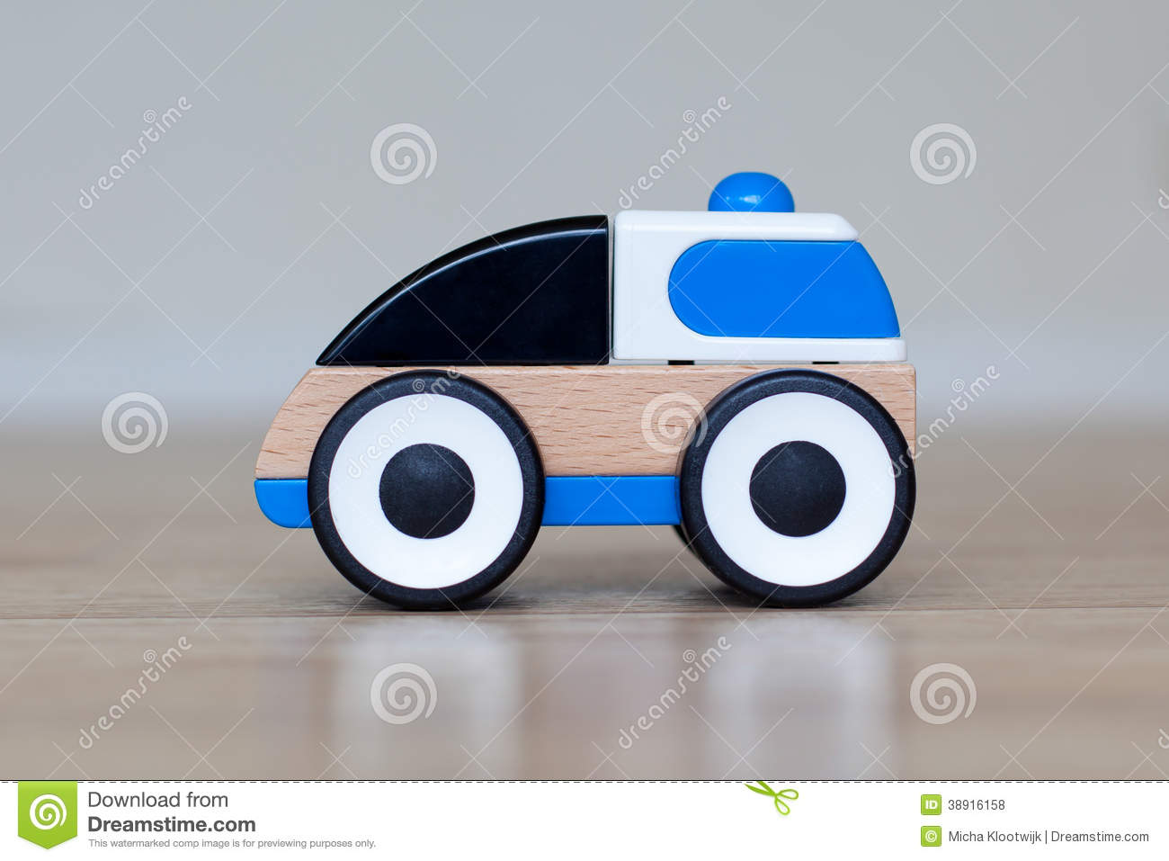 Simple Wood And Plastic Toy Police Car Stock Photo.